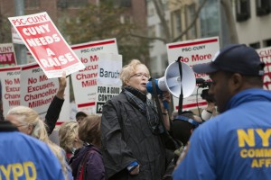 PSC Union President Barbara Bowen leads CUNY faculty and staff at a protest this past month as they call for an end to the contract dispute that has left them without raises for six years.