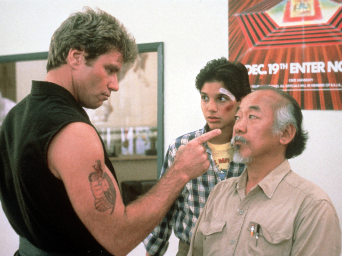 "Martin Kove, left, Ralph Macchio and Pat Morita in a scene from the 1984 motion picture ""The Karate Kid."" CREDIT: Columbia Pictures [Via MerlinFTP Drop]"