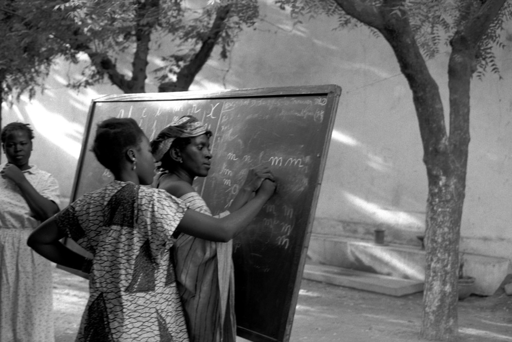 MALI. Town of Bamako. 1994. Alphabetisation class organised by the catholic church for young maids.